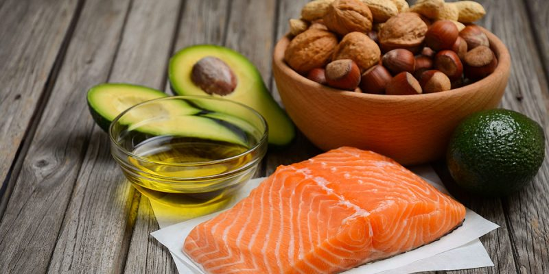 Selection of healthy fat sources. Rustic background. Horizontal permission. Selective focus. Copy space.